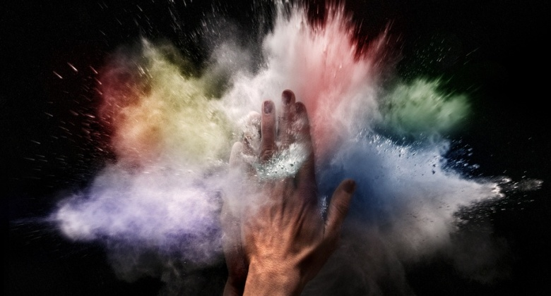 hand and coloured powder